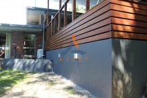 Low level timber deck, rendered wall underneath, Kenmore